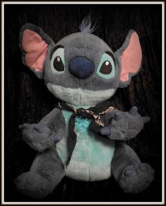 My Stitch plush... and yes that's a bandana around his neck.
