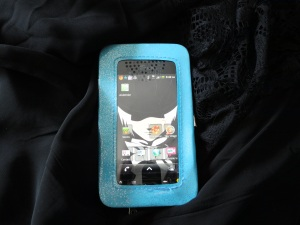 Front has protective plastic window with an opening on bottom for a button (or camera?) and then speaker holes at the top. I couldn't decide which way the phone was ment to go in, lol. And yeah, Alan Walker from D-Grayman is my wallpaper! :P